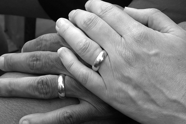 Photo of married couple's hands.